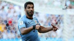 Indosport - Luis Suarez selebrasi gol pertama Uruguay