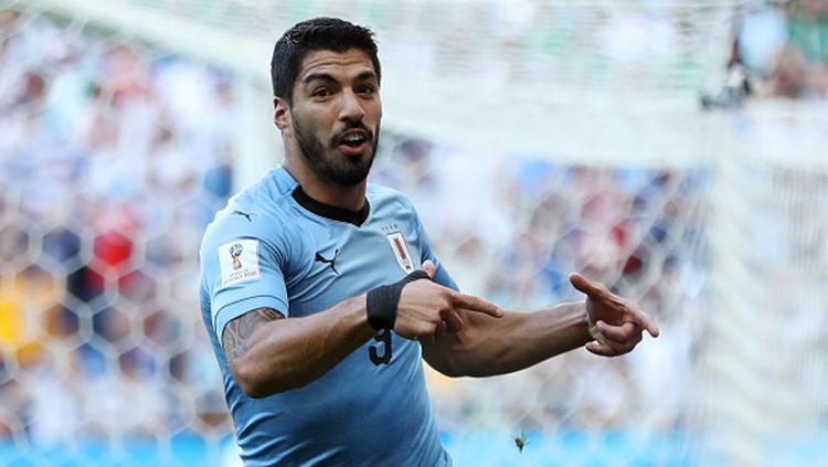 Luis Suarez selebrasi gol pertama Uruguay Copyright: Getty Images