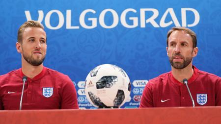Striker dan pelatih Timnas Inggris, Harry Kane (kiri) dan Gareth Southgate. - INDOSPORT