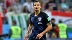 Indosport - Dejan Lovren dalam laga Argentina vs Kroasia di Piala Dunia 2018.