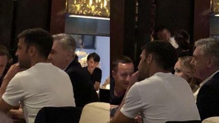 Cesc Fabregas dan Carlo Ancelotti terlihat makan malam bersama di salah satu restoran Rusia. - INDOSPORT