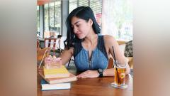 Indosport - Venilia Agik, presenter cantik Indonesia untuk Piala Dunia 2018