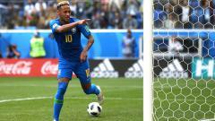 Indosport - Neymar merayakan golnya ke gawang Kosta Rika di Piala Dunia 2018.