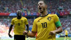 Indosport - Eden Hazard merayakan golnya ke gawang Tunisia