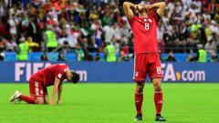 Indosport - Ekspresi kekecewaan pemain Iran, Morteza Pouraliganji, setelah kalah dari Spanyol di Piala Dunia 2018.