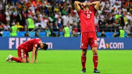 Ekspresi kekecewaan pemain Iran, Morteza Pouraliganji, setelah kalah dari Spanyol di Piala Dunia 2018. - INDOSPORT