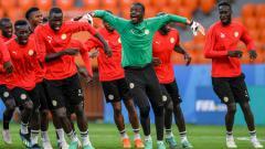 Indosport - Sesi latihan Senegal dengan yel-yel dan tarian di Piala Dunia 2018.
