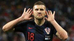 Indosport - Pemain Kroasia, Ante Rebic, selebrasi usai bobol gawang Argentina di Piala Dunia 2018.