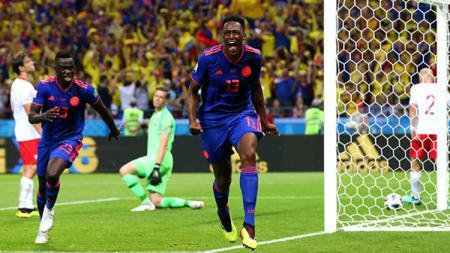 Selebrasi Yerry Mina setelah berhasil mencetak gol ke gawang Polandia di Piala Dunia 2018. - INDOSPORT