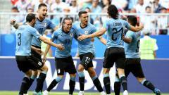Indosport - Pemain Uruguay selebrasi dalam laga kontra Rusia di laga ketiga Grup A Piala Dunia 2018.
