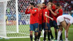 Indosport - Isco bersama para pemain Spanyol merayakan gol.