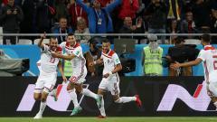 Indosport - Para pemain Maroko merayakan gol yang dicetak ke gawang Spanyol.
