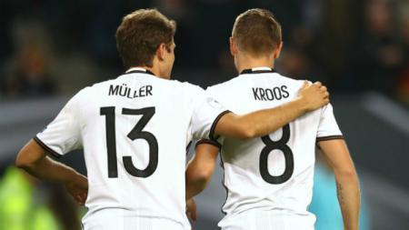 Dua pemain penting Timnas Jerman, Thomas Muller dan Toni Kroos. - INDOSPORT