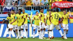 Indosport - Para pemain Kolombia merayakan gol yang dicetak Yerry Mina.