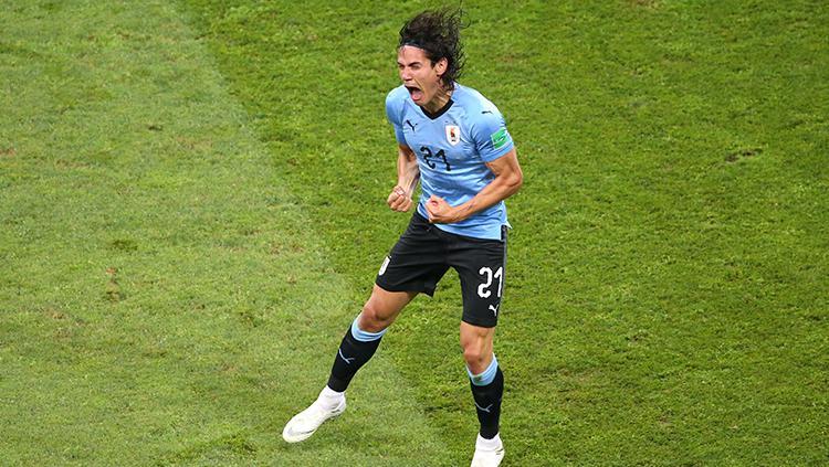 Edinson Cavani merayakan golnya ke gawang Portugal. Copyright: INDOSPORT