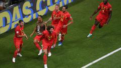 Indosport - Marouane Fellaini berselebrasi usai membuat Belgia mengejar ketertinggalan dari Belgia.