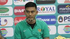 Indosport - Rafli Mursalim saat konferensi pers usai laga melawan Singapura U-19.