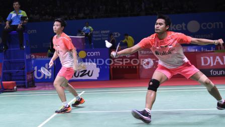 Tontowi Ahmad/Liliyana Natsir ketika bertanding melawan ganda campuran asal Jepang, Yugo Kobayashi/Misaki Matsutomo, di Indonesia Open 2018, Kamis (05/07/18). Herry Ibrahim/INDOSPORT