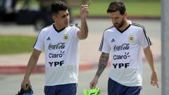 Indosport - Cristian Pavon (kiri) dan Lionel Messi di Timnas Argentina.
