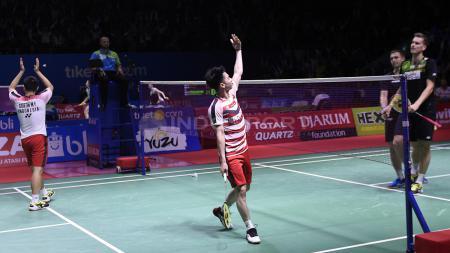 Aksi Kevin Sanjaya usai meraih kemenangan atas ganda Denmark. - INDOSPORT