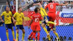 Indosport - Sundulan Harry Maguire membuka keunggulan Inggris atas Swedia di Piala Dunia 2018.