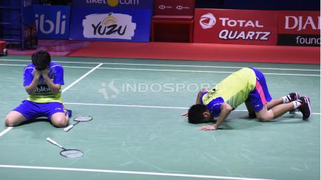 Ganda Campuran Indonesia Tontowi Ahmad dan Liliyana Natsir meluapkan kegembiraan Indonesia Open 2018. - INDOSPORT