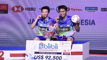 Ganda Campuran Indonesia Tontowi Ahmad dan Liliyana Natsir juara Indonesia Open 2018. - INDOSPORT