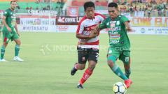 Indosport - Madura United vs PSMS Medan.