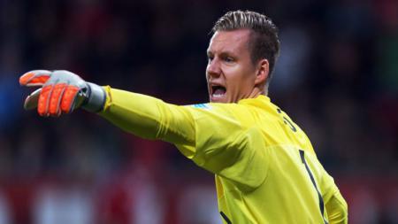 Kiper baru Arsenal, Bernd Leno, saat masih berseragam Bayer Leverkusen. - INDOSPORT