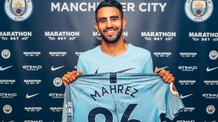 Riyad Mahrez resmi pindah klub dari Leicester City menuju Man City. - INDOSPORT