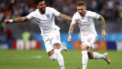 Indosport - Kieran Tripper (kanan) berselebrasi usai mencetak gol ke gawang Kroasia.