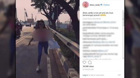 Dinar Candy menepati janjinya berlari tanpa pakaian usai Prancis ke final Piala Dunia 2018. - INDOSPORT