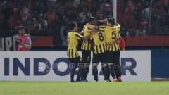 Indosport - Pemain Malaysia melakukan selebrasi.
