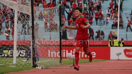 Feby Eka melakukan selebrasi usai mencetak gol ke gawang Thailand. - INDOSPORT