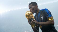 Indosport - Paul Pogba merayakan kemenangan Prancis di Piala Dunia 2018.