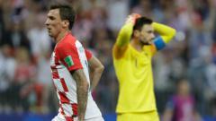 Indosport - Hugo Lloris melakukan blunder di final Piala Dunia 2018.