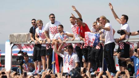 Kroasia melakukan selebrasi setelah berhasil mencatatkan sejarah di Piala Dunia 2018. - INDOSPORT