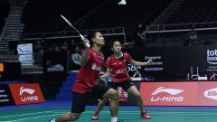 Indosport - Pasangan ganda campuran Indonesia, Akbar Bintang Cahyono/Winny Oktavina Kandow.