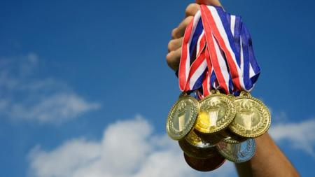 Ilustrasi medali emas. - INDOSPORT