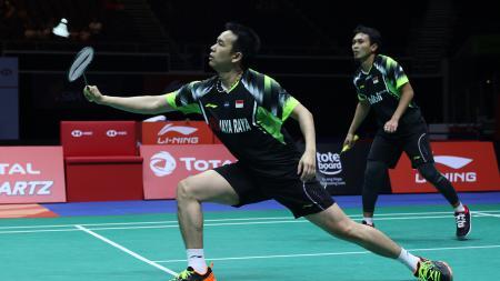 Mohammad Ahsan dan Hendra Setiawan di kejuaraan Singapore Open 2018. - INDOSPORT