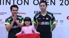 Indosport - Mohammad Ahsan dan Hendra Setiawan di kejuaraan Singapore Open 2018.