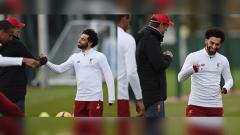 Indosport - Keakraban Mohamed Salah dan Jurgen Klopp dalam sesi latihan.