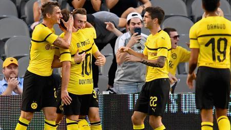 Selebrasi para pemain Borussia Dortmund. - INDOSPORT