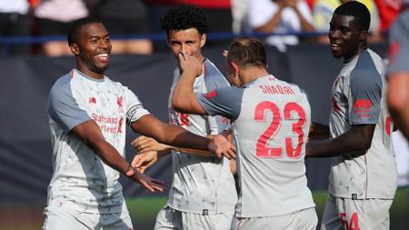 Pemain Liverpool melakukan selebrasi. - INDOSPORT