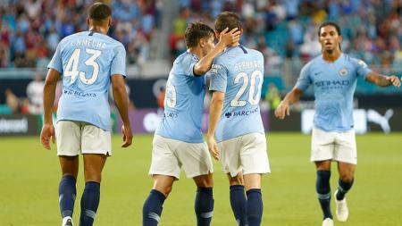 Pemain Manchester City merayakan golnya ke gawang Bayern Munchen. - INDOSPORT