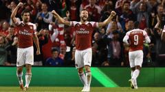 Indosport - Pemain Arsenal merayakan gol ke gawang Chelsea.