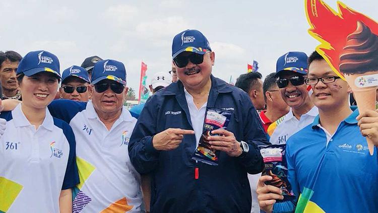 Alex Noerdin (tenagh) pawai obor Asian Games 2018. Copyright: AICE