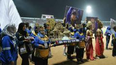 Indosport - Tumpeng berbentuk Candi sebagai bagian seremonial.