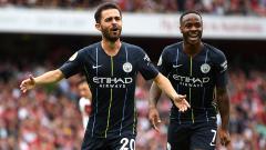 Indosport - Bernardo Silva mencetak gol kedua bagi Man City saat mengalahkan Arsenal.