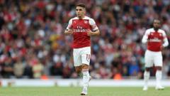 Indosport - Lucas Torreira masuk di menit ke 70 dalam laga melawan Man City